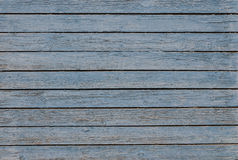 Peeling blue paint. Wooden background with peeling blue paint royalty free stock photo