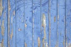 Peeling blue paint on wooden door or fence Stock Photos