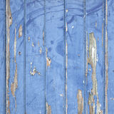 Peeling blue paint on wooden door or fence Stock Image