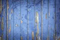 Peeling blue paint on wooden door or fence Stock Photo