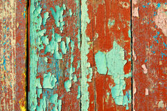 Peeling brown and blue paint on old weathered wood - textured background Stock Photography