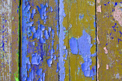 Peeling brown and purple paint on old weathered wood - textured background Stock Image
