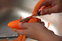 Peeling carrot Royalty Free Stock Photo