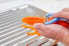 Peeling a carrot Stock Photos