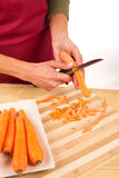 Peeling carrots Stock Photo