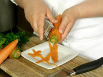 Peeling carrots Royalty Free Stock Photos