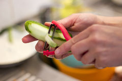 Peeling cucumber Stock Photo