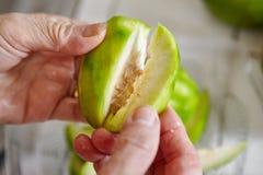 Peeling and cutting ambarella Royalty Free Stock Image