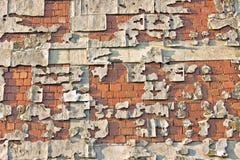 Peeling facade brick wall Stock Image