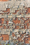Peeling facade brick wall Stock Photos