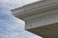 Peeling Facia. This is weather beaten, dried, cracked and peeling soffit and fascia Stock Images