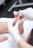 Peeling feet pedicure procedure Royalty Free Stock Photos