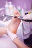 Peeling feet pedicure procedure in a beauty salon Stock Photography