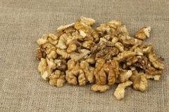 Peeling fresh walnuts, walnut dessert preparation. Walnuts on the kitchen table. Healthy food. Stock Image