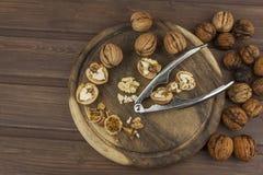 Peeling fresh walnuts, walnut dessert preparation. Walnuts on the kitchen table. Healthy food. Stock Photo
