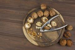 Peeling fresh walnuts, walnut dessert preparation. Walnuts on the kitchen table. Healthy food. Stock Photography