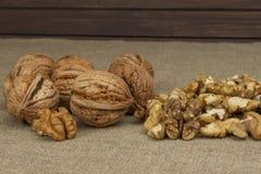 Peeling fresh walnuts, walnut dessert preparation. Walnuts on the kitchen table. Healthy food. Royalty Free Stock Photo