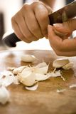 Peeling garlic Stock Images