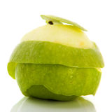 Peeling green apple Royalty Free Stock Image