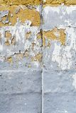 Peeling grey paint on limestone brick. Worn and peeling grey paint on limestone brick stock photos