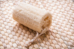 Peeling loofah on wicker mat healthcare concept Royalty Free Stock Images