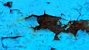 Peeling, neglect, cracked, rusty, rough blue paint background. royalty free stock photography