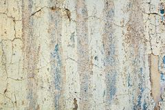 Peeling of old white wall stock image