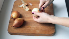 Peeling the onion at home stock footage