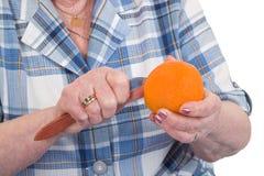 Peeling an orange Stock Photography