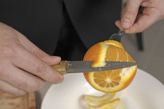 Peeling an orange Royalty Free Stock Photo