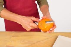 Peeling an orange Royalty Free Stock Image