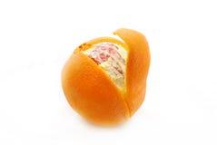 Peeling orange. A peeling orange on a white background Royalty Free Stock Images