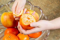 Peeling Orange Fruit by Hand Royalty Free Stock Photo