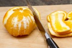 Peeling an orange Stock Photo