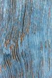 Peeling Paint - Background. Peeling blue paint on an old door royalty free stock photo