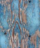 Peeling Paint - Background. Peeling blue paint on an old door royalty free stock image