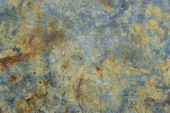 Peeling paint blue rusty textured metal background. 