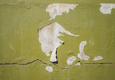Peeling paint on concrete wall. Exterior of building Stock Photos