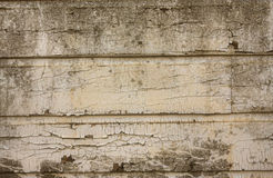 Peeling paint on grunge  wall Stock Photo