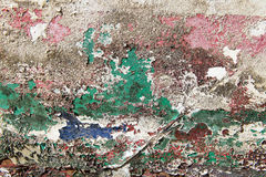 Peeling paint layers. Old layers of paint peeling from the side of a wooden boat Stock Images