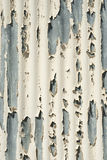 Peeling paint from metal surface Stock Image