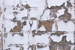 Peeling paint off a brick wall Stock Image