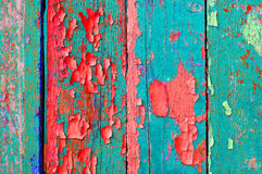 Peeling paint on old weathered green and red wood - textured background Stock Image