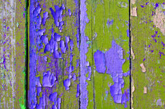 Peeling paint on old weathered green and violet wood - textured background Royalty Free Stock Photo