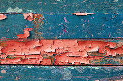 Peeling paint on old weathered wood - texture wooden background Stock Images