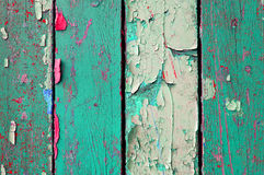 Peeling paint on old weathered wood - texture wooden background Royalty Free Stock Photo