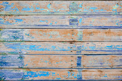 Peeling paint on an old wooden wall. Obsolete Stock Image