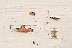 Peeling paint over brick wall Stock Image