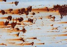 Peeling paint on  rusted metal surface Stock Image