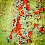 Peeling paint on rusty metal background Royalty Free Stock Image